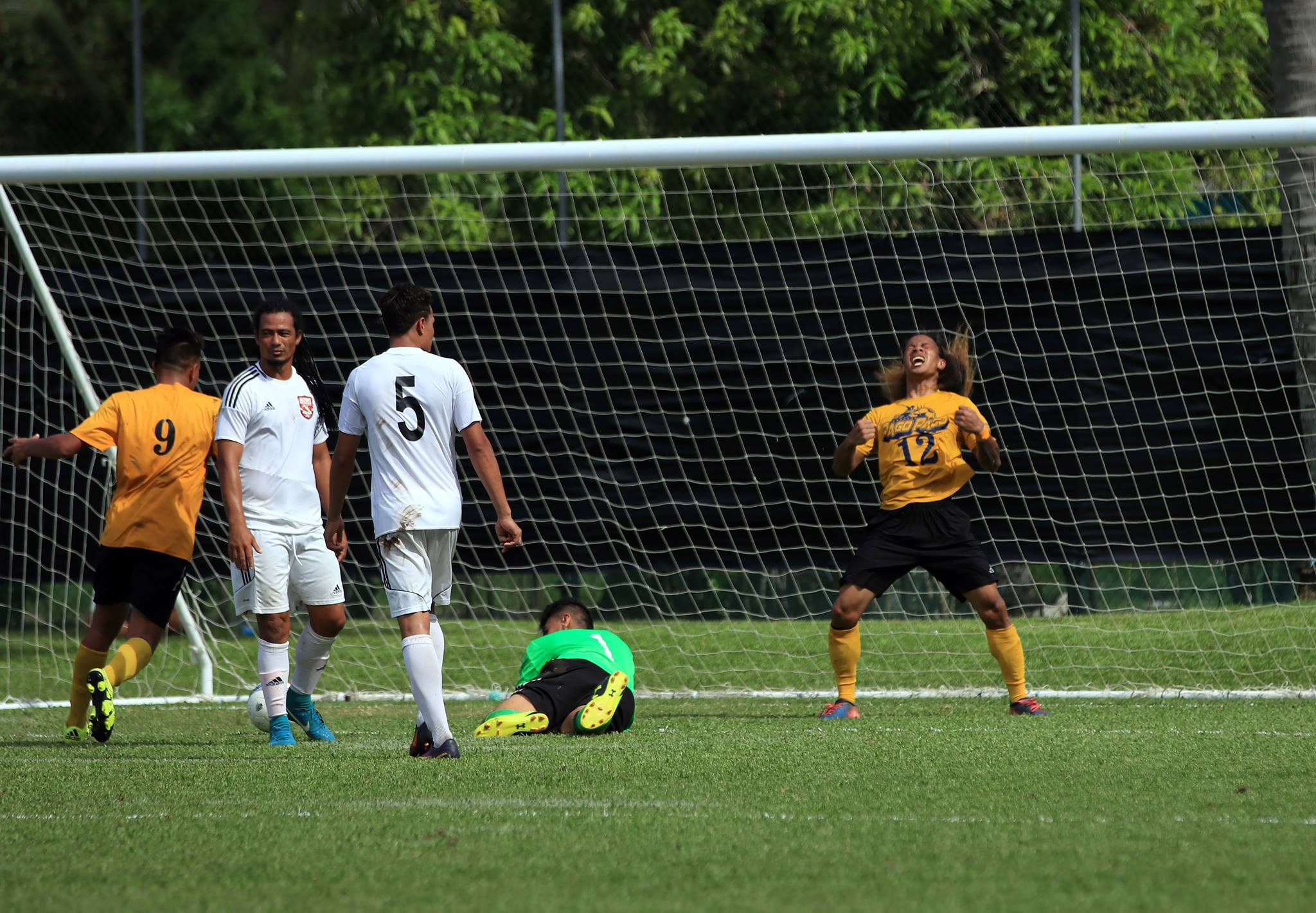 Palauni Tapusoa of Pago Youth celebrates his first of three goals against Kiwi FC